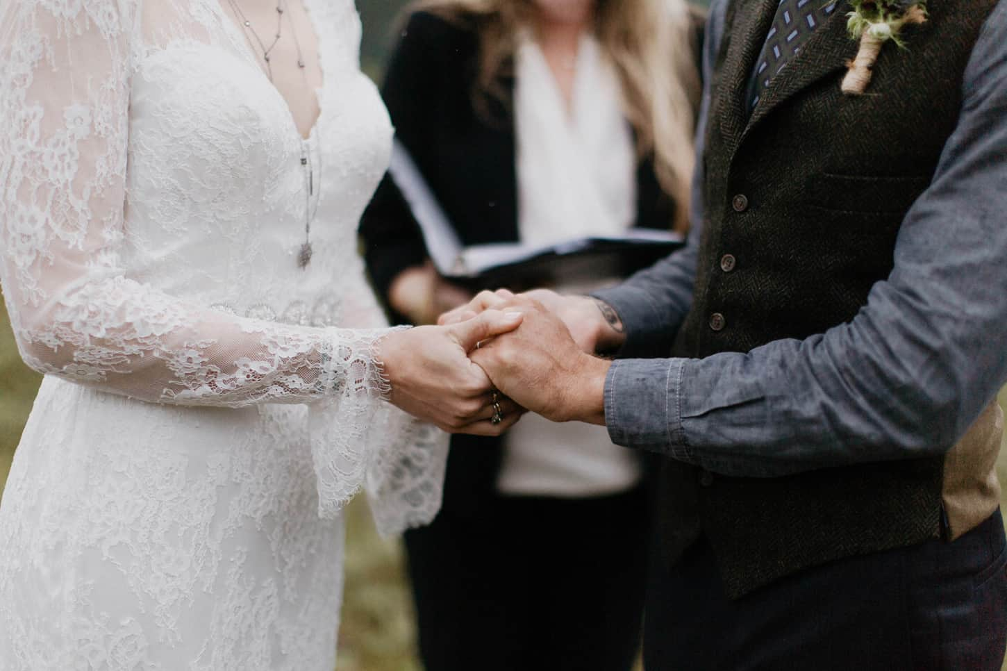 bride and groom holding hands on wedding day